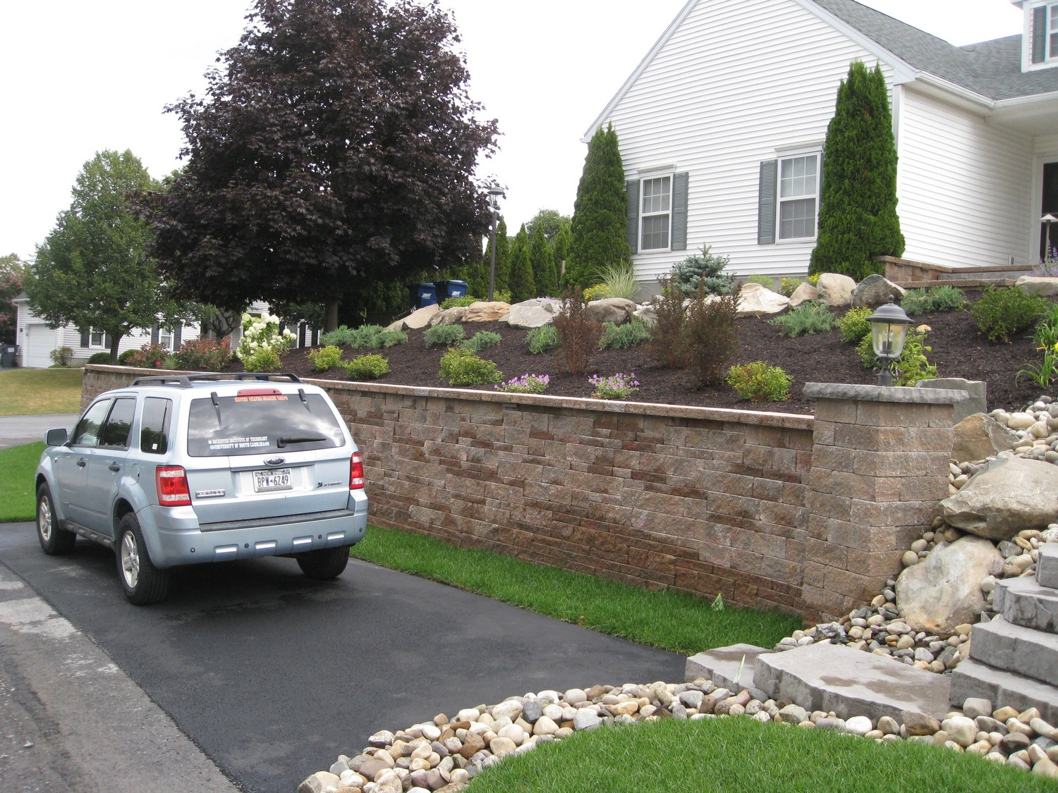 landscape retaining walls gardening on a slope using stones in the garden