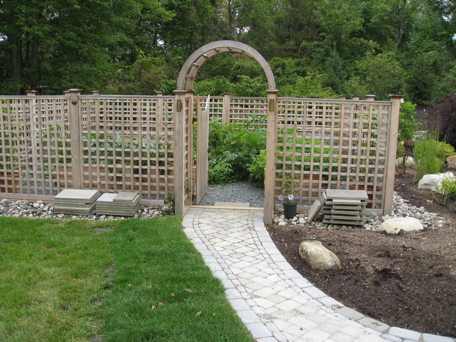 Cedar Fenced vegetable garden design Latham NY