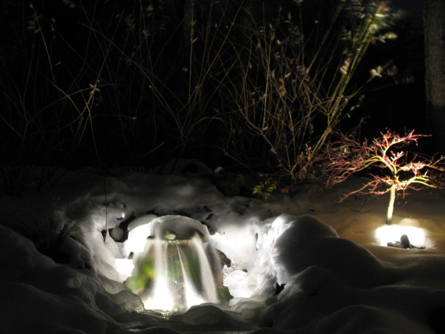 Latham NY waterfall winter snow landscape design lighting